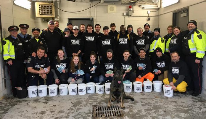 Members of the Peterborough Police Service Auxiliary Unit, Special Constables, Torch Run Team members, Canine Unit Constable Cowie and Police Service Dog Isaac, civilians, Fleming College students, and family members helped to raise $32,000 in donations during the annual Easter Tolls for Special Olympics on April 20, 2019. (Photo courtesy of Peterborough Police Service)