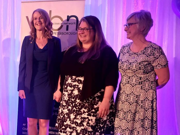 Monika Carmichael (left) after being named the recipient of the 2019 Women in Business Award for business leadership at the Women's Business Network of Peterborough's Women in Business Award and Judy Heffernan Award dinner at Personal Touch Banquet Hall in Peterborough on April 9, 2019. Also pictured are the two finalists for the award: Erin McLean of McLean Berry Farm and Bridget Leslie (right) of My Left Breast. Earlier in the evening, Kim Appleton was announced as the winner of the 2019 Judy Heffernan Award for empowering women. (Photo: Jeannine Taylor / kawarthaNOW.com)