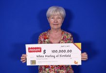 Wilma Marling of Kirkfield with her $100,000 prize. (Photo courtesy of OLG)