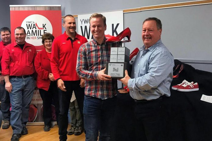 Craig and Tom Mortlock of Mortlock Construction with their awards for top individual and team fundraisers for the 2018 YWCA Walk a Mile in Her Shoes, at the April 4, 2019 launch of the 2019 event. (Photo courtesy of YWCA Peterborough Haliburton)