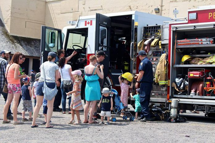 Families explore a fire truck from Peterborough Fire Services during the 2018 Touch-A-Truck event at The Canadian Canoe Museum. (Photo courtesy of The Canadian Canoe Museum)