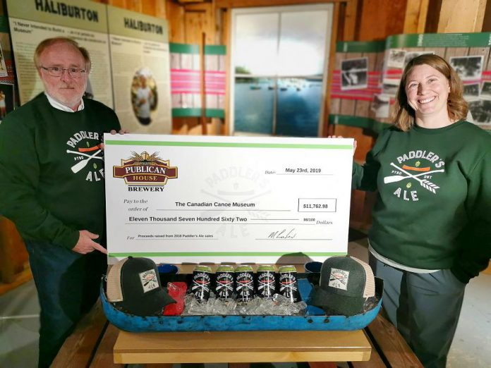 Publican House Brewery partner Marty Laskaris presents a cheque for $11,762.98 to The Canadian Canoe Museum's executive director Carolyn Hyslop on May 23, 2019. The funds were raised through the sale of the brewery's Paddler's Ale and associated merchandise in 2018. (Photo courtesy of The Canadian Canoe Museum)