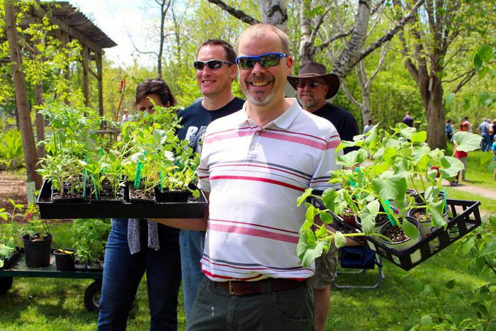 Customers at last year's GreenUP Ecology Park Plant Sale show off their plant purchases. This year, this annual fundraiser for Ecology Park will be held on Saturday, May 18th from 10 a.m. to 4 p.m. (Photo: Karen Halley)