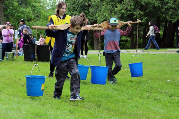At the Pioneer Water Race activity centre at the 2018 Peterborough Children's Water Festival, children experienced first hand how difficult it is to carry water and gained an appreciation for the water that we have piped directly into our homes, schools, and businesses. (Photo: Karen Halley / GreenUP)