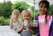 Students attending the 2018 Peterborough Children's Water Festival hold up their favourite invertebrates. The Otonabee Conservation activity centre allowed children to get up close with many aquatic bugs and insects to understand how their unique features allow them to live in water. Last year's festival had registration numbers, prompting the festival's steering committee to add a third day in 2019. (Photo: Karen Halley / GreenUP)