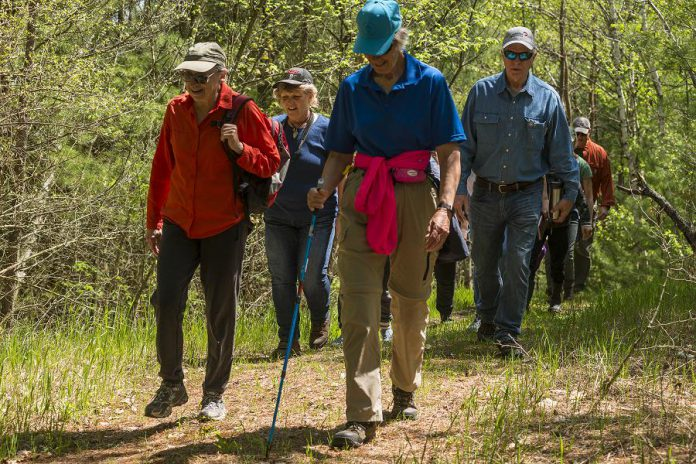 Jean Garsonnin (front left) joined the morning Indigenous Medicine Walk on May 26, 2019. She has owned the  260-acre McKim-Garsonnin property with her husband Ralph McKie since 1986, restoring the land and its ecosystems and turning it into a nature lover's delight. The property is protected by Kawartha Land Trust through a Conservation Easement Agreement. (Photo: Anica James)