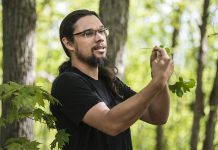 Joe Pitawanakwat, founder and director of indigenous outdoor-education based business Creators Garden, holds a leaf from a bloodroot plant during a guided indigenous medicine walk at Ballyduff Trails, located on the McKim-Garsonnin property protected by Kawartha Land Trust. He explained the use of the highly toxic plant in traditional medicine to help treat fibroids and as an aid for pregnancy. (Photo: Anica James)