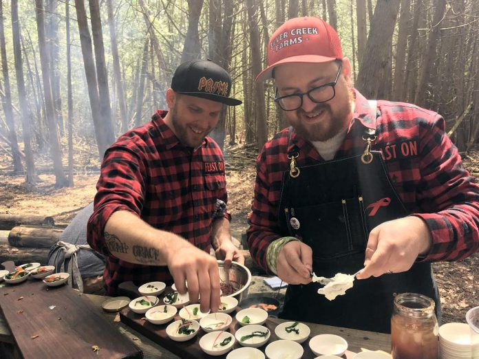 Chefs Eric Boyar from SixThirtyNine in Woodstock and Tyler Scott from Rare Grill House in Peterborough preparing their rainbow trout dish for the Terroir Symposium's Rural Retreat at South Pond Farms in Pontypool on May 7, 2019. (Photo: Eva Fisher / kawarthaNOW.com)