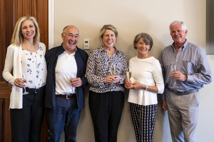 At the Lakefield College School trustees' meeting in Victoria, British Columbia on May 4, 2019, John and Jane Hepburn (second from left and second from right) share a toast with Lakefield College School board chair Nicole Bendal (left), Lakefield College School head of school and foundation Anne-Marie Kee, and Lakefield College School Foundation board chair Jock Fleming in celebration of the Hepburns' $15-millon donation to the school. (Photo courtesy of Lakefield College School)