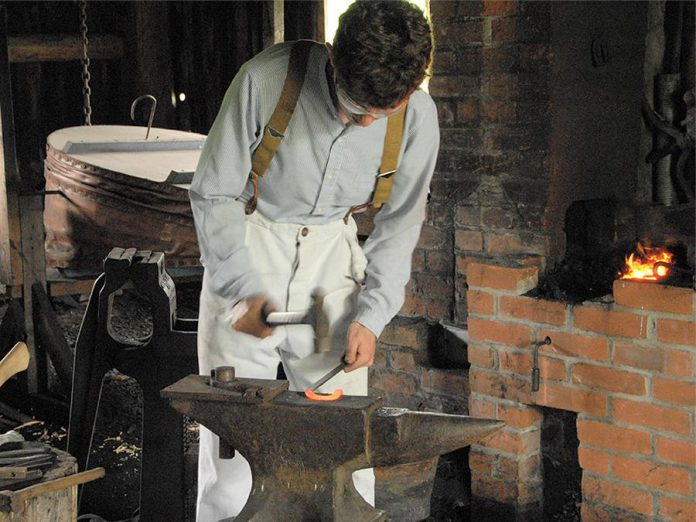 A blacksmith at work at Lang Pioneer Village Museum in Keene.  (Photo courtesy of Lang Pioneer Village Museum)