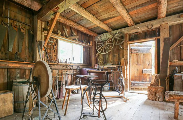 Lang Pioneer Village Museum, the award-winning living history museum in Keene, opens during the week for its 52nd season on May 21, 2019, and will open daily beginning on Sunday, June 16th with the 23rd annual Father's Day Smoke & Steam Show. Pictured is the museum's carpenter shop. (Photo courtesy of Lang Pioneer Village Museum)