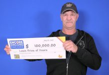 Louis Prins picking up his $100,000 cheque at the OLG Prize Centre in Toronto. He won the prize by matched six of the seven Encore numbers in exact order in the May 17, 2019 Lotto Max draw. (Photo: OLG)