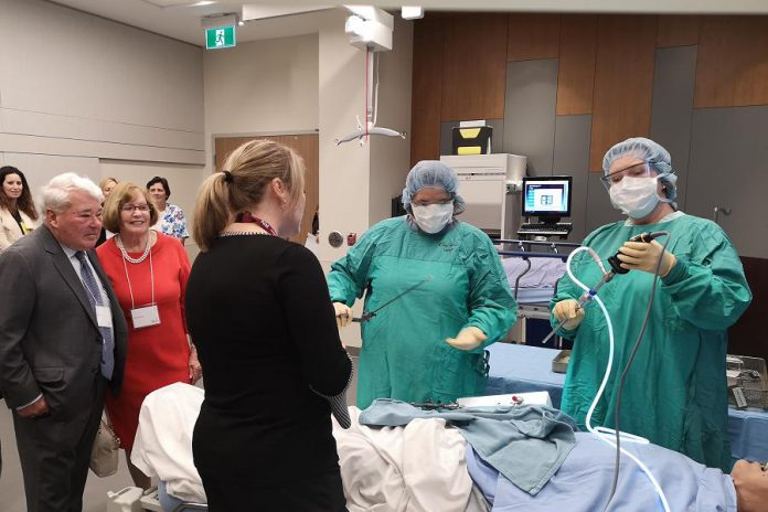 Donors Martin and Denise Pick (left) watch a demonstration in the clinical training room at the new Martin and Denise Pick Learning Centre at Peterborough Regional Health Centre on May 14, 2019 with nurse educator Christine Emrich (back to the camera), with  other community donors and PRHC staff.  (Photo: Natasha Roulston / Peterborough Regional Health Centre)