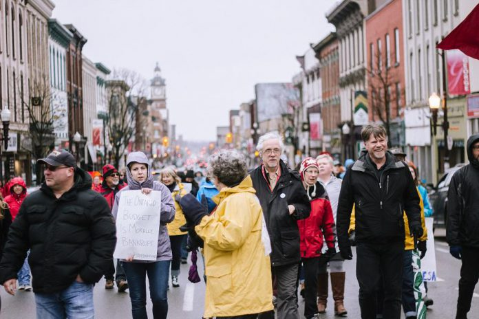"On May 1, 2019, around 300 people gathered at Confederation Square in downtown Peterborough as part of the ""May 1st General Strike Against Ford"" and marched along George Street and Hunter Street. (Photo: Thayla Fortin)"