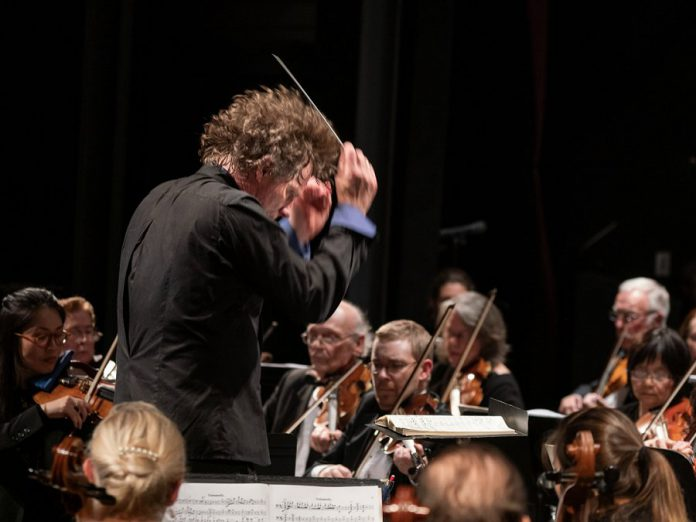 "Maestro Michael Newnham conducting the Peterborough Symphony Orchestra during its ""Romantik"" concert on November 3, 2019. He says the PSO's performance of Berlioz's ""Symphonie fantastique"" is another milestone for the orchestra. (Photo:  Huw Morgan)"