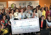Some of the members of 100 Women Peterborough with representatives from Five Counties Children's Centre, including 15-year-old client Rebecca Jordan and board chair Adam White (both holding the cheque). The non-profit organization that provides therapy services for children will receive more than $10,000 from the group. (Photo courtesy of 100 Women Peterborough)