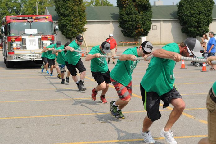 A team uses a front-pull strategy during a previous Pulling for Dementia Fire Truck Pull. Before pulling, teams are taught the proper technique during a practice round to get the best result and avoid any injury. (Photo: Bianca Nucaro / 705 Creative)