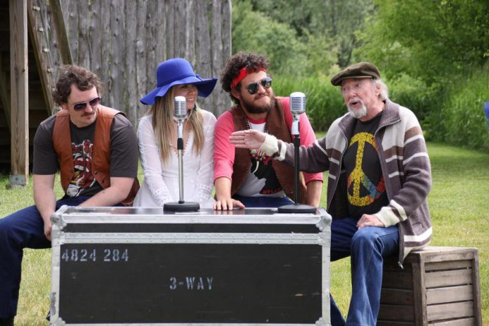 """Owen Stahn, Kate Suhr, and Griffin Clark act out a scene from """"Bloom: A Rock 'n' Roll Fable"""" with Geoff Hewitson (who plays the role of a CHUM Radio DJ as well as portraying legendary Peterborough band leader and music promoter extraordinaire Del Crary) during a media day at 4th Line Theatre on June 19, 2019. (Photo: Jeannine Taylor / kawarthaNOW.com)"""