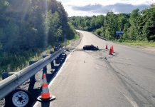 A motorcycle has been destroyed by fire and the driver is in hospital with life-threatening injuries following an accident on Highway 118 in Highlands East on June 16, 2019. A passenger also suffered injuries. (Photo: Bancroft OPP)