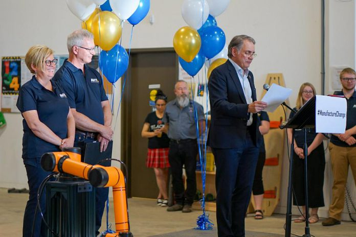 Dennis Darby, president and CEO of Canadian Manufacturers & Exporters, speaks at the open house and rebranding of Steelworks Design as AVIT Manufacturing on June 6, 2019 at the company's facility at 1961 Fisher Drive in Peterborough, as company co-founders Rhonda and Don Barnet look on. (Photo: AVIT Manufacturing)