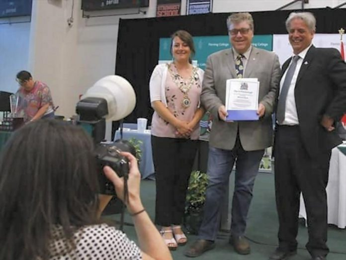 Peterborough Folk Festival Malcolm Byard accepts a Civic Award on behalf of Ryan Kemp and himself from City of Peterborough Mayor Diane Therrian and Councillor Dean Pappas. (Photo: Peterborough Folk Festival / Facebook)