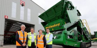 Peterborough-based McCloskey International, which employs around 900 people in Canada, the U.S.A., and Northern Ireland, has been acquired by Finnish industrial machinery company Metso. Pictured are McCloskey International founder, president, and CEO Paschal McCloskey (second from left) and Ian Lough of McCloskey International (far right), along with Mark Nodder and Jeremy Fitch of Invest Northern Ireland at Granville Industrial Estate in County Tyrone in Northern Ireland. (Photo: McCloskey International)