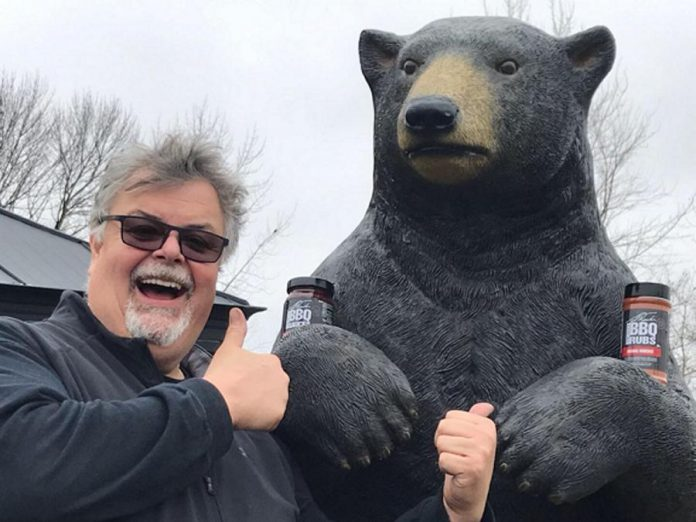 "Chef Ted Reader with 7&46 Shop's resident mascot Corneilius the Bear. Known as ""Godfather of the Grill"", Reader will be grilling at 7&46 Shop on June 14, 2019 as part of the Kawartha Lakes eatery and giftware destination's fifth anniversary celebrations. (Supplied photo)"