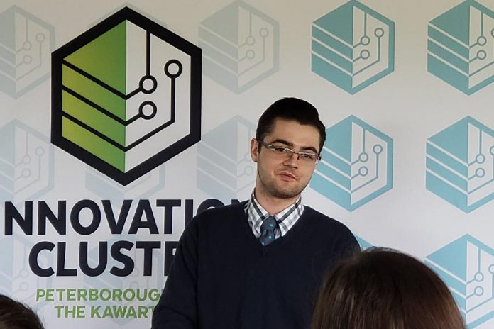 Innovation Cluster client Dylan Trepanier of Alexander Optical, who was a winner in the  the 2019 Bears' Lair Entrepreneurial Competition, speaks about the role of the economic development organization in his successful startup at the Innovation Cluster's annual general meeting on May 30, 2019. (Photo courtesy of the Innovation Cluster)