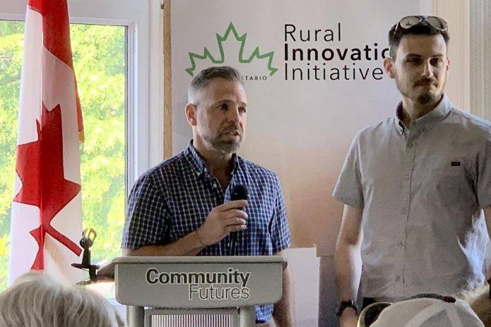 Cambium president and CEO John Desbiens (left) speaks at Community Futures Peterborough's annual general meeting on June 27, 2019, where it was announced that the Peterborough-based consulting and engineering company Cambium has won the inaugural ignite100 enterpreneurial competition. The prize is a $100,000 loan, interest-free for the first three years with no payments for the first year. (Photo: Mike Skinner / Twitter)