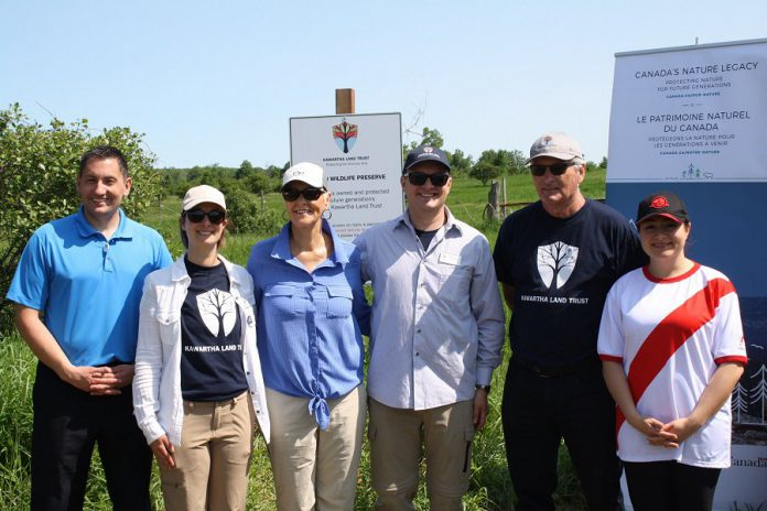 Kawartha Land Trust (KLT) has received $215,000 in funding from the Canadian government's Canada Nature Fund to support the continued protection of the Cation Wildlife Preserve near Coboconk. Peterborough-Kawartha MP Maryam Monsef announced the funding during the grand opening of the preserve on June 22, 2019. Pictured (left to right): Haliburton-Kawartha Lakes-Brock MP Jamie Schmale, KLT development manager Tara King, land donor Sharon Cation, KLT executive director John Kintare, land donor Dave Cation, and MP Monsef. (Photo: Office of Maryam Monsef)