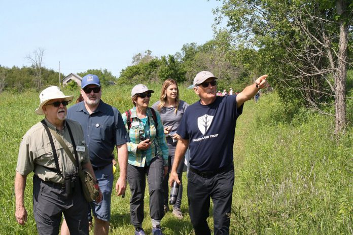 Land donor Dave Cation participates in a guided walking tour during the grand opening of the Cation Wildlife Preserve near Coboconk  on June 22, 2019. The preserve includes marked trails for passive recreational use by the public, including hiking, snowshoeing, and cross-country skiing. (Photo: Office of Maryam Monsef)