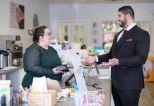 Sarah Susnar, owner and operator of family activity studio Play Cafe, meets with Waleed Dabbah of Dabbah Corp. Sussner says Dabbah is not only knowledgeable, responsive, and friendly, but he saved her business 40 per cent over the best rate the banks offered for a point of sale system. (Photo: 705 Creative / kawarthaNOW)