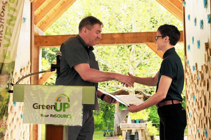 Peterborough—Kawartha MPP Dave Smith presents a certificate to GreenUP executive director Brianna Salmon at an event held at Ecology Park on June 25, 2019, recognizing a $24,900 capital grant provided to GreenUP by the Ontario Trillium Foundation to install a low-water irrigation system at the park. Smith has been appointed parliamentary assistant to the Minister of Energy, Northern Development and Mines and Minister of Indigenous Affairs. (Photo: GreenUP)