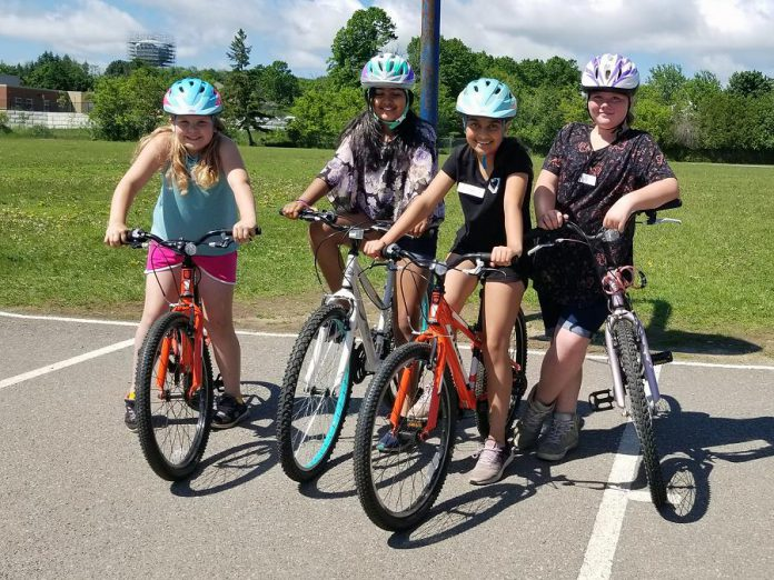 Grade 5 students from St. Anne Catholic Elementary School learn bike handling skills and rules of the road that will help them become safe and confident bike riders. (Photo: Jaime Akiyama)