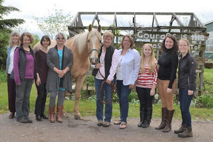 The team behind the Building Internal Resilience Through Horses program (left to right): Cheryl Wood, Beverley Clifton, Dr. Kateryna Keefer, Susan Hardy, Sunny the horse, Jennifer Garland, Sonya Vellenga, Nicole Oattes, Katie McKeiver, and Vivianne Burmester. (Supplied photo)