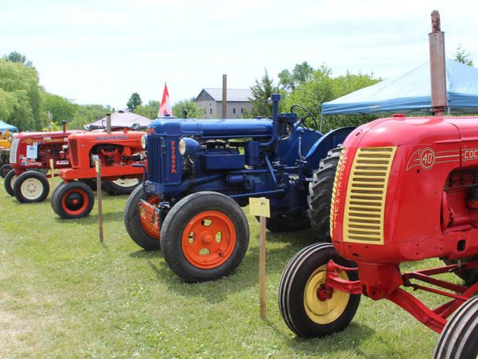 Antique tractors on display at the 2018 Father's Day Smoke & Steam Show.  (Photo courtesy of Lang Pioneer Village Museum / Facebook)