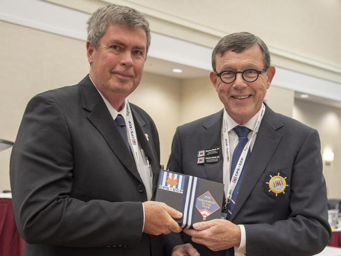 Peterborough Power and Sail Squadron commander Nick Cliteur (left) accepts the Squadron of the Year award from CPS-ECP Chief Commander Chuck Beal in 2018. Cmdr. Beal attended the squadron's 60th annivesrary celebration on June 7, 2019 at the Marshland Centre in Lakefield. (Photo: Don Butt)