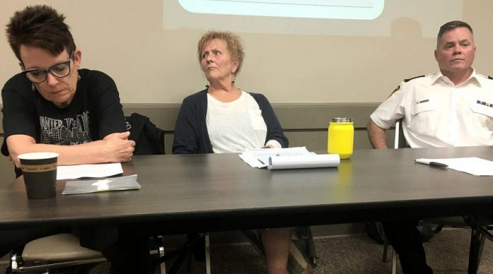 Whitepath Consulting and Counselling Services owner Peggy Shaughnessy (left) during a June 12th public meeting on Peterborough's opioid crisis at the Lions' Community Centre in Peterborough. As a frontline expert in drug overdose, treatment, and counselling, Shaughnessy was disappointed that she wasn't initally invited to participate on the panel for the July 11th 'Opioid Summit' being hosted by Peterborough Mayor Diane Therrien and Selwyn Deputy Mayor Sherry Senis. Following negative reaction from some members of the community, Mayor Therrien has now invited Shaughnessy to participate. Peterborough Deputy Police Chief Tim Farquharson (right) is already participating on the July 11th panel, which PARN executive director Kim Dolan (centre) will be moderating. (Photo: Paul Rellinger / kawarthaNOW)