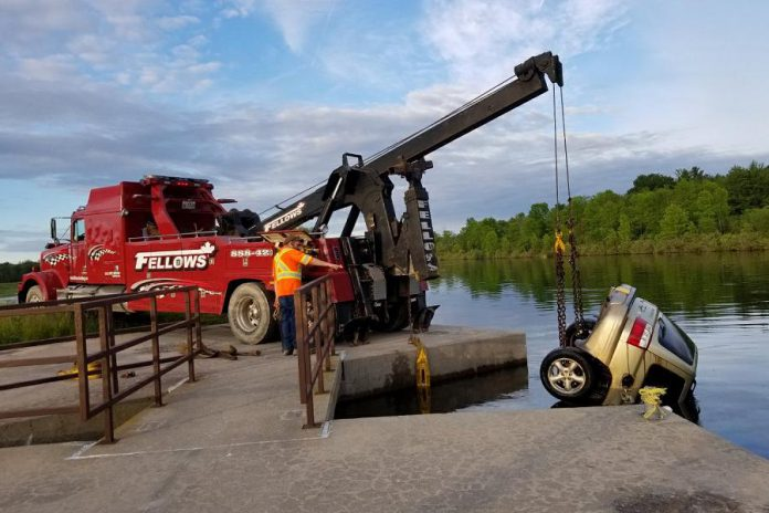 A car is removed from the Trent Severn Waterway near Brighton after two unidentified bodies were discovered in the submerged vehicle on June 17, 2019. (Photo: @OPP_CR / Twitter)