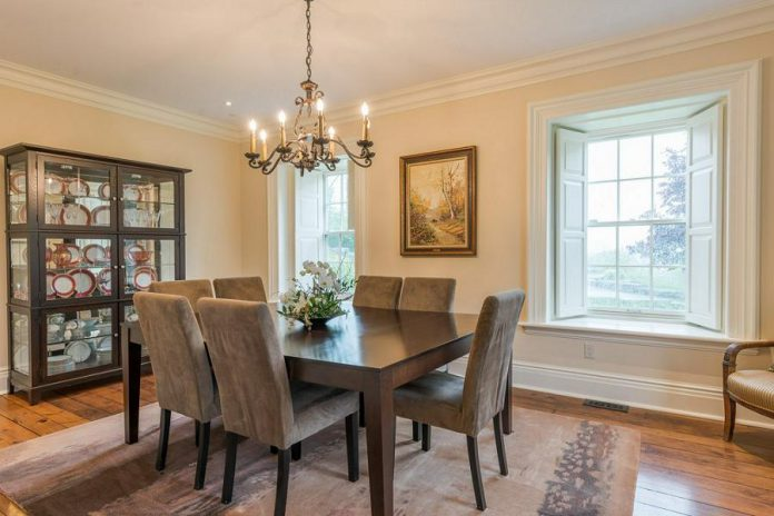 The remodelled formal dining room. High-quality maple and pine hardwood floors are featured throughout the home.