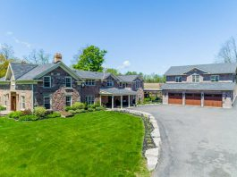 Located on a 100-acre private rural property on the west edge of Peterborough, 124 Lily Lake Road features a stunning stone villa with 6,200 square feet of luxurious living space, along with an outdoor area with a patio, deck, heated in-ground pool, tennis court, and a three-car garage.