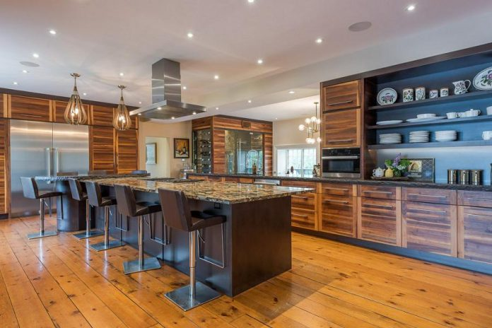 The contemporary multipurpose kitchen was designed with entertaining in mind, with the open-plan interior creating an easy flow between the dining room and family room.
