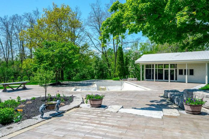 The outdoor area includes a heated inground pool, a tennis court, and a baseball diamond on the east lawn.