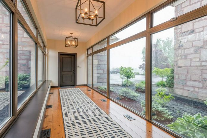 The home features a main floor wing connected by a walkway that would lend itself to an in-law situation if needed.