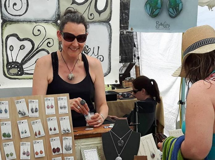 Karen Cameron of Bella Grey Jewellery Design combines Georgian Bay beach stones with colourful paper decoupage and lead-free silver solder. She is one of the vendors who will be participating in the Finer Things summer show and sale at Del Crary Park in August. (Photo courtesy of Finer Things)