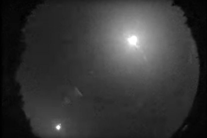 A still from a video of a fireball (upper right) captured by Western University's All-Sky Camera Network at 2:44 a.m. on July 24, 2019. As bright as a full moon (the waning moon is pictured in the lower left), the fireball disintegrated south of Bancroft and is likely to have dropped small meteorites in the area. (Photo: Western University)