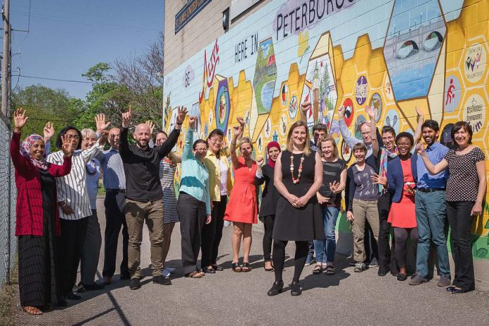 New Canadians Centre executive director Hajni Hõs (front) with her team from the New Canadians Centre. (Photo: Heather Doughty / Inspire: The Women's Portrait Project)
