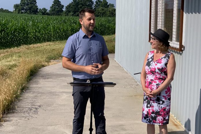 Dancing bee founder and CEO Todd Kalisz with Northumberland-Peterborough South MP Kim Rudd during the announcement of $65,000 for the beekeeping equipment business in Port Hope on July 29, 2019. (Photo: Office of Kim Rudd)