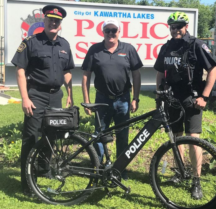 City of Kawartha Lakes Police Chief Mark Mitchell (left) and Constable Kevin Walden (right) with an electric mountain bike donated by Allen Hussey of Pedego Kawartha Lakes (centre). (Photo: Kawartha Lakes Police Service)