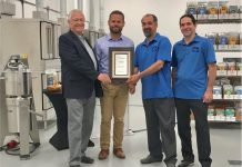 Darren and Ryan Goldin of Etomo Farms in Norwood (right) receive an inaugural Excellence in Agriculture Award from Ontario Minister of Agriculture, Food and Rural Affairs Minister Ernie Hardeman and Northumberland-Peterborough South MPP David Piccini on July 4, 2019, in recognition of the company's innovation in producing food products from crickets. (Photo: Ontario Ministry of Agriculture, Food and Rural Affairs)